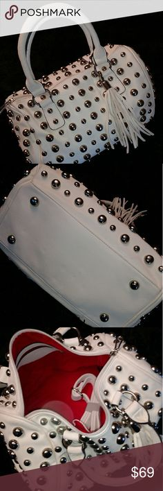 "Rocker Chic Studded Satchel! Turn heads with this awesome Rocker Chic Studded Satchel! Vegan leather & stainless steel studs, good sized but not overpowering, medium sized bag..    10"" x 12"" not including the handles. Killer deal for this HOT statement piece! Bags Satchels"