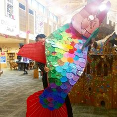 Gonna have a school of salmon in the library soon. Showing some pacific northwest marine wildlife love at the Lacey library this month. Similarly to the dragon, kids who signed up for the summer reading program decorated the scales.