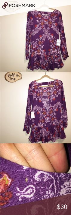 NWT Free People Floral Dress I cannot get over how adorable this dress is! It is long sleeved with the cutest ruffle trim on the bottom. The back has a plunging V and would look great with a lacy bralette, cami, or backless bra. This dress is super versatile and could be perfect for a summer evening or even winter over a pair of jeans or leggings. There is a very small whole (pictured) on the right side of neckline, but is barely noticeable and easily stitched up. Free People Dresses Long…