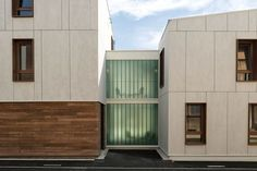 24 Housing Units by Zanon + Bourbon Architects, Nancy, France. Facade panels are Equitone Tectiva, drilled by metal frames including lacquered wood windows.
