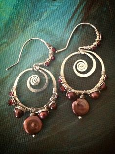 Freshwater pearls and red garnets wrapped in sterling silver on swirling Gypsy Lotus ear wires.