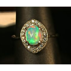 INVOICE for Stephen. Stunning Ethiopian Opal Halo Ring. Matching opal... ($355) ❤ liked on Polyvore featuring jewelry, earrings, marble earrings, white topaz stud earrings, 14 karat gold stud earrings, opal stud earrings and stud earrings