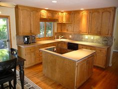 Like the back splash with these oak cabinets and light counters. It really seems to modernize the kitchen without tearing out the old cupboards and counters.