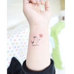 cat-holding-flower-tattoo-by-tattooist_banul