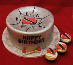 Steel pan cake and cupcakes with Trinidad flag