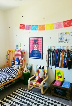 Love the eclectic mix of popping colours and the open wardrobe in this children's bedroom