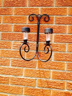 Outdoor lighting.  Sconce from the thrift store and dollar store solar lights!  Cheap and Easy