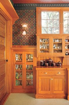 Details like the lack of modern toekicks, exposed cabinet hinges, and the lower hanging height of upper cabinets help new cabinets read like vintage ones.