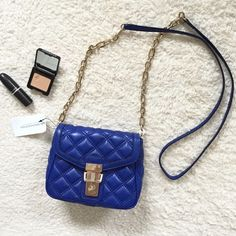 Banana Republic Quilted Crossbody Bag Cute faux leather quilted crossbody purse from BR. NWT - I've never worn it. Beautiful and vibrant bright blue color with very light gold hardware (could pass as silver depending on the light). Sold out quickly and is super popular little bag. Perfect pop of color to glam up any outfit! Please ask any and all questions! Thank you for looking! Banana Republic Bags Crossbody Bags