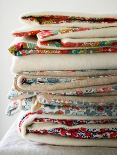 Liberty and Wool Lap Duvets - the purl bee - simple tutorial for making warm lap blankets using just 1 yard wool felt and one yard cotton fabric.