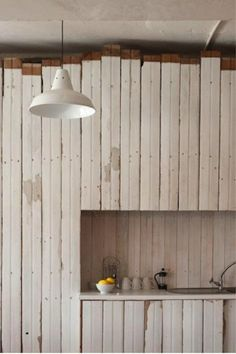 Reclaimed white wood boards form a little bar area/coffee nook. Via (lovely Shoppe artist) Anca Gray.