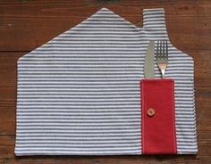 These would be a great house warming gift.   placemat - blue & white stripes. $13.00, via Etsy.