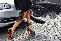 "Long black sheer skirt and Christian Louboutin ""Daffodil"" platform pumps."