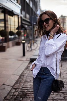 Simple white button down shirt and skinny jeans outfit with Chanel Rectangular minit  | ELLE | By Didem | Didem Özgun