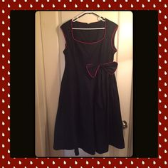 Black Dress with Bow Dress is not true to size. Size says 4x but it is closer to 1x in my opinion. Very cute. Black with red trim. NWOT. From a pet friendly & NON smoking home! Dresses Midi