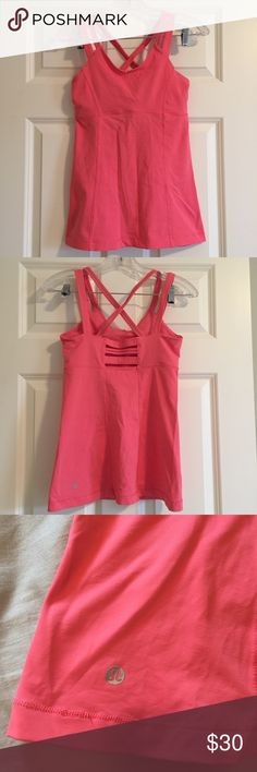 Gently used lululemon Yoga tank I can't remember if the size is 4 or 6 and I ripped the tag out, but it fit me when I was 32C-34D. Happy to take measurements if interested!! By lululemon. It is a yoga tank with a built in bra in a gorgeous coral color. lululemon athletica Tops Tank Tops