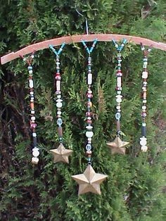 beaded suncatchers on a wooden hanger
