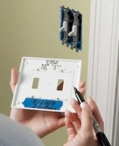 Never again forget your room's paint color choice! On the inside of your light switch or outlet cover, using a permanent marker, just write the date, paint brand, color name, swatch number on a piece of painter's tape for quick reference