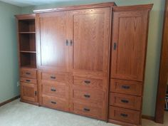Our customer from Indianapolis, Indiana chose the BedderWay Vertical Queen Dresser Cabinet Face Murphy bed in oak stained Traditional Cherry with two 24'' side cabinets. To see more styles please visit www.bedderway.com