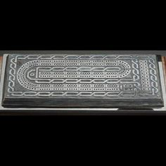 This cribbage board was originally commissioned by an avid tournament player. The track design is standard to facilitate fast paced play and ornamented for the joy of regular use.