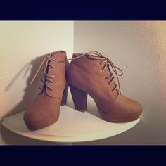 The heel is a little taller than I preference. Brown taupe color, lace up, wooden type heel. Really good condition. Worn out twice only. Very small scuff mark, on middle side of the shoe. Refer to last picture. Price negotiable, use offer button!(: Shoes Ankle Boots & Booties