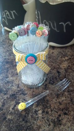 Cute As A Button party! Decorate forks with a button glued the handle and display in a mason jar!
