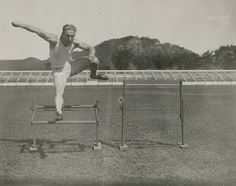 Intra-mural track and field athlete running hurdles on the fairgrounds, La Crosse County, Wisconsin, 1920s. Source: UW-La Crosse Archives and Special Collections.
