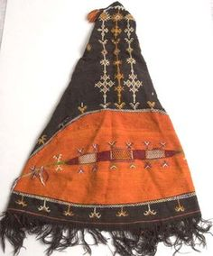 An akhnif is a cloak worn in Morocco by Jewish and Berber males. The eye shape is thought to be protection against the evil eye.