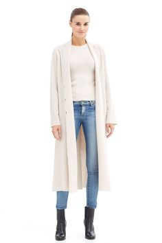 """Crafted from pure luxurious cashmere, this statement coat is a great piece to add to your outerwear collection. Featuring a double-breasted button closure at front with a slit at back hem.                                                              Fabric: 100% cashmere.                                           Fit: True to size. Model is wearing size small.             Model Measurements: height: 5'11 / bust: 34"""" / waist: 24"""" / hips: 35""""."""