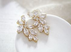 """These delicate, rose gold cubic zirconia cluster stud bridal earrings are perfect for a bride or bridesmaid! Made with a variety of marquise cut CZ stones for beautiful sparkle. - Earrings measure 1.4375"""" x 0.75"""" - High quality cubic zirconia - Available in rose gold, yellow gold and silver finishes This is an original design by © Treasures by Agnes"""