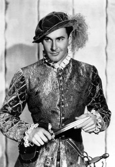 Errol Flynn in a promotional photo for The Prince and the Pauper Look at that impish grin! Hollywood Actor, Golden Age Of Hollywood, Classic Hollywood, Old Hollywood, Hollywood Pictures, Sean Flynn, Errol Flynn, Olivia De Havilland, Captain Blood