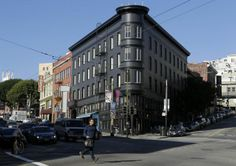 This flatiron building from 1907 at Columbus Avenue and Kearny Street in North Beach used to be cream with white trim, but last year it was repainted charcoal with onyx accents.
