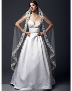 """BV1307 by BV1307 // More from BV1307: http://www.theknot.com/gallery/bridal-accessories/blossom-veils....108"""" veil fully trimmed with handbeaded and embroidered swarovski crystals and fresh water pearls. All veils are customizable to any length in a variety of standard colors."""