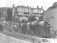 """The tunnelling work on the Eastern Suburbs Railway Line was speeded up by a tunnel boring machine,called """"The Mole"""" shown here at the Woollahra Portal. Tunnel Boring Machine, Metro Rail, Mole, Old Photos, Sunsets, Portal, Trains, Sydney, Past"""