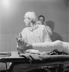 British nurse assisting with a leg operation in the General Hospital in Tobruk during 1942.