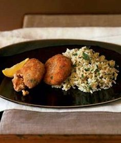Salmon Cakes With Lemon Rice Ingredients 2 14 3/4-ounce cans red or pink salmon, drained, any skin and large bones removed 1 1/4 cups dry bread crumbs 1/4 cup mayonnaise 1 large egg, beaten 1 tablespoon Worcestershire sauce 1/4 cup capers, drained 1 1/2 teaspoons dried tarragon kosher salt and black pepper 2 cups instant brown rice 4 tablespoons vegetable oil 2 tablespoons minced fresh parsley (optional) 1 tablespoon extra-virgin olive oil 1 tablespoon fresh lemon juice 1 lemon, quartered