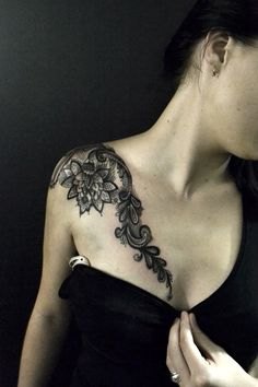 Abstract tattoo, mandala  ish, lace style over the shoulder - very cool