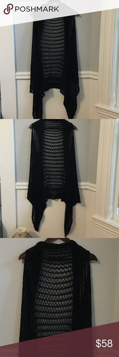Long Draped Hand Knit Boho Draped Open Vest Black This is a stunning piece that was purchased at a local artist's event. It is a hand knit/crochet? black yarn w a slight sheen. This is a fun light layer that can be worn in so many ways! Wear is over a crop top for a BOGO look. Wear it to the beach as a coverup! Wear it with a long sleeve cotton shirt and jeans and boots! One size. Please feel free to make a reasonable offer. Bundle and auto save 15% on 2+ items in my closet. Bundle your…
