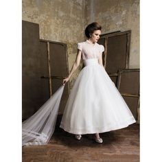 Vintage wedding dress with short sleeves and tea length. Organza bodice. Free made-to-measurement service for any size. Available colors seen as in Color Options. SKU ST0000090353