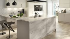 A range of fashionable Sheraton kitchens with smooth, matt doors available in six colours, shown here in Ivory and Cashmere. More details available at www.sheratonkichens.co.uk