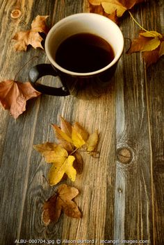 www.arcangel.com - mug-of-coffee-on-wooden-table-with-autumn-leaves