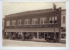 A. Hood & Sons Implement Company, Columbus, Kansas  Date: 1914  This is a photograph of the building which housed The A. Hood & Sons Implement Company, 116 West Pine Street, Columbus, Ks. In 2007, Jason & Lisa Hulvey purchased the building and the Evan's Drug Store business from Evan McNemar.