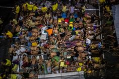 QUEZON CITY, PHILIPPINES 10/19/2016 President Rodrigo Duterte's ruthless antidrug campaign led to overcrowded prisons. At this city jail, inmates took turns sleeping in any available space, including a basketball court.