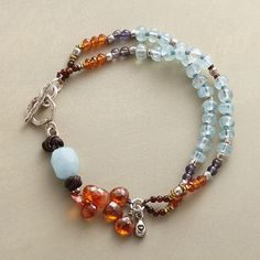 """SUNSHOWER BRACELET $118 garnet and aquamarine bracelet, hessonite garnets stand in for the sun; aquamarines for a shower. A handcrafted exclusive with sterling silver beads and toggle clasp. 7-1/4""""L."""