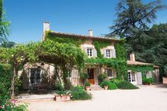 Take me there now...what a beautiful looking French house