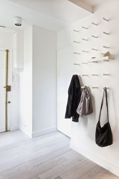 Brilliant & Beautiful: 5 New Ways to Hang Coat Hooks | Apartment Therapy // for the wall by the door - dowel pegs, small shelf