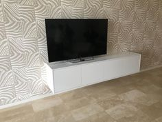 Contemporary, white, wall mounted entertainment unit.  (Customer Installation) Bespoke Furniture Gallery Wall Mounted Entertainment Unit, Wall Units, Bespoke Furniture, Flat Screen, The Unit, Contemporary, Gallery, Blood Plasma, Roof Rack