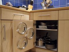 "Use ""command hooks"" (adhesive strips) to store the lids to pots & pans right on the cabinet door!"