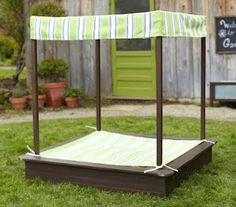 DIY Sandbox with seats, sun canopy and cover.