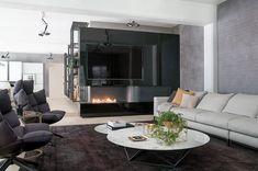 Bruleur ethanol et télévision dans le salon d'un loft http://www.a-fireplace.com/fr/bruleur-ethanol/
